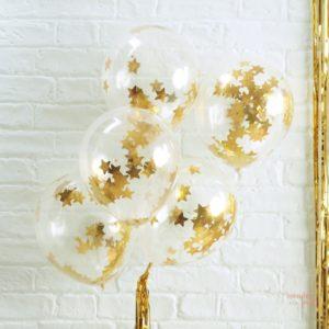 Globos transparentes con confetti estrellas doradas ideales para decorar fiestas con estilo wonder party bcn fiestas tematicas barcelona